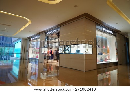 SHANGHAI, CHINA - Apr.19 2015: Interior of the luxury kerry centre shopping mall at downtown in old French Concession. Multi luxury brand inside. - stock photo