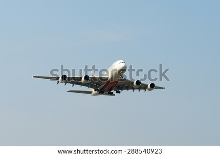 SHANGHAI, CHINA, April 2,  2015: Emirates Airline Airbus A380 (A6-EEC)flying in the sky. Airbus A380 is the world's biggest jet airliner