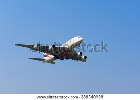 SHANGHAI, CHINA, April 2,2015: Emirates Airline Airbus A380 (A6-EEC)flying in the sky. Airbus A380 is the world's biggest jet airliner - stock photo