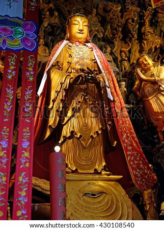 SHANGHAI, CHINA - April 21, 2016: Golden Buddha statue at the Jade Buddha Temple in Shanghai, founded in 1882 with two jade Buddha statues imported to Shanghai from Burma by sea. - stock photo