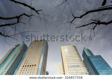 SHANGHAI, CHINA, APRIL 1: Modern skyscrapers in Shanghai with silhouette of trees in downtown. China 2013 - stock photo