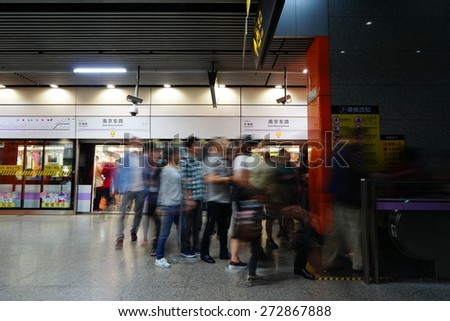 SHANGHAI CHINA - APRIL 25, 2015. Passengers in the subway station in Shanghai.
