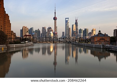 SHANGHAI, CHINA - DEC. 19, 2012: Pudong at Sunset in Shanghai, China. Pudong has become the engine of the economic and social development of Shanghai after two decade of development in China. - stock photo