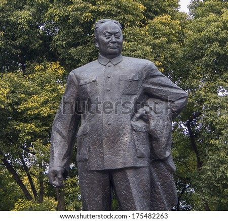 SHANGHAI, CHINA - DECEMBER 14, 2013: Statue of Chen Yi, first mayor of Shanghai on the Bund in Shanghai. This 5.6m high bronze sculpture was erected at 1993