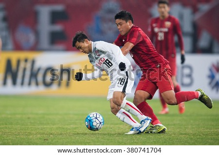 SHANGHAI-CHINA FEBRUARY 09:Chanathip Songkrasin (L)of Muangthong Utd  in action during The AFC Champions League2016 Playoff Shanghai SIPG and Muangthong Utd at Shanghai Stadium on Feb 09,2016 in China