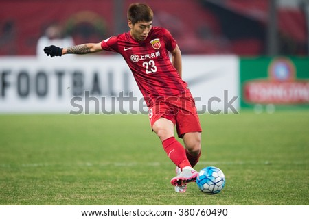 SHANGHAI-CHINA FEBRUARY 09:	Fu Huan no.23 (red) of Shanghai SIPG in action during The AFC Champions League 2016 Playoff Shanghai SIPG and Muangthong Utd at Shanghai Stadium on Feb 09,2016 in China - stock photo