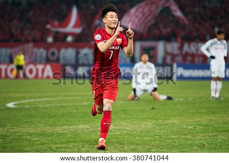 SHANGHAI-CHINA FEBRUARY 09:Wu Lei (red) of Shanghai SIPG celebrates his goal during The AFC Champions League 2016 Playoff Shanghai SIPG and Muangthong Utd at Shanghai Stadium on Feb 09,2016 in China - stock photo