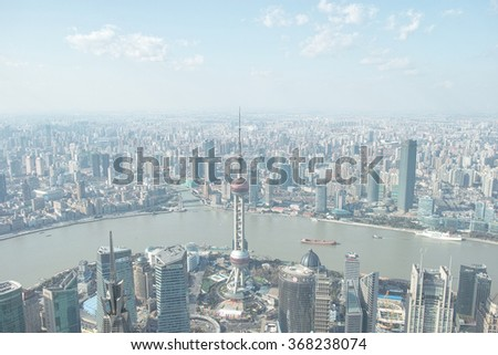 Shanghai, China - Jan. 23, 2016: Shanghai skyline viewed from the top of Shanghai World financial center in afternoon.