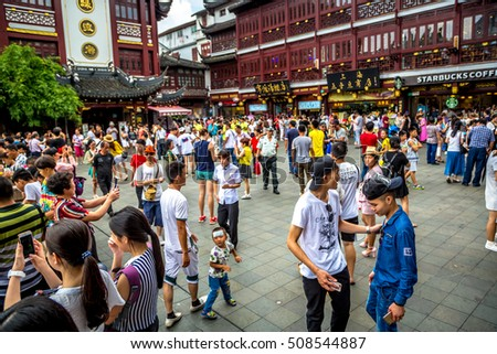Shanghai, China - July 22nd 2016 - Tourists enjoying the Yu Garden attraction in a blue sky day in Shanghai, China, Asia.