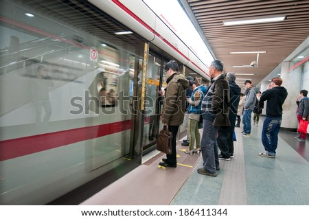 SHANGHAI, CHINA - MARCH 20: Chinese pepole waits for a train in People's Square Metro Station - interchange between Lines 1, 2 and 8 on March 20, 2013 in Shanghai