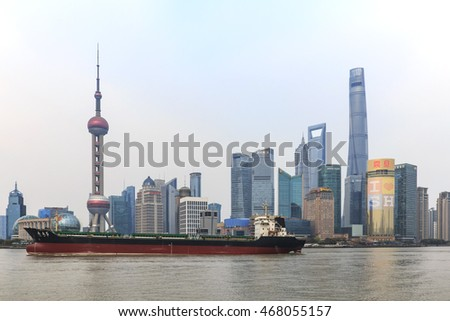 Shanghai, China: March 26, 2016: Day view of the Bund, the most scenic spot in Shanghai with the most famous Chinese skyscrapers