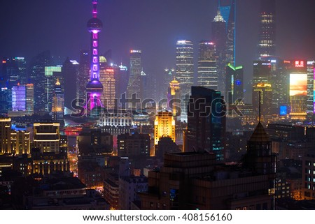 SHANGHAI, CHINA - MARCH 19, 2015: Famous skyscrapers of Shanghai, Pudong commercial district at night.