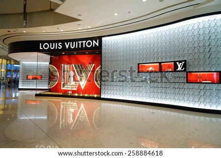SHANGHAI, CHINA - March 8. 2015: Interior of the IFC Shopping Mall downtown in Pudong Lujiazui. LOUIS VUITTON Just The international women's day at March 8. 2015 Shanghai, China - stock photo