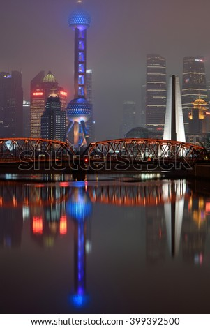 SHANGHAI, CHINA - MARCH 19: Pudong district night view from Suzhou Creek on March 19, 2016 in Shanghai, China. Pudong is a district of Shanghai, located east of the Huangpu River. - stock photo