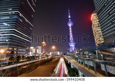 SHANGHAI, CHINA - MARCH 20: Pudong district night view on March 20, 2016 in Shanghai, China. Pudong is a district of Shanghai, located east of the Huangpu River. - stock photo