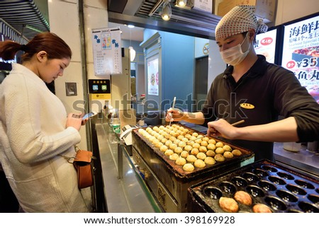 SHANGHAI, CHINA - MARCH 18: Street food at Nanjing Road on March 18, 2016 in Shanghai, China. Nanjing Road is the main shopping street of Shanghai, and is one of the world's busiest shopping streets. - stock photo