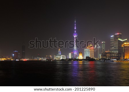 SHANGHAI, CHINA - MAY 2: A skyline view across the Bund at night on May 2, 2014 in Shanghai, China. Shanghai is the largest Chinese city by population of more than 24 million as of 2013