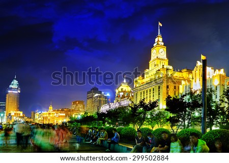 SHANGHAI, CHINA - MAY 23, 2015:Beautiful view of  Shanghai - Bund or Waitan waterfront at night. Shanghai waterfront Bund has historical buildings is one of the most famous tourist places in Shanghai. - stock photo