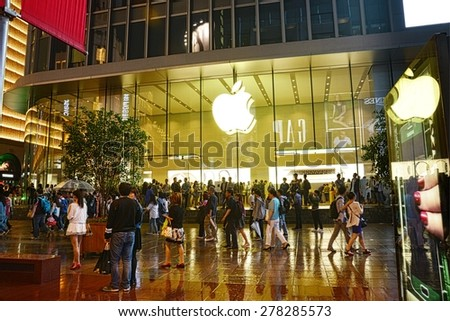 SHANGHAI, CHINA - MAY 2, 2015: Exterior of the Apple store at Nanjing Road a week after the release of the Apple Watch. This shopping street of Shanghai is one of the world's busiest shopping streets.