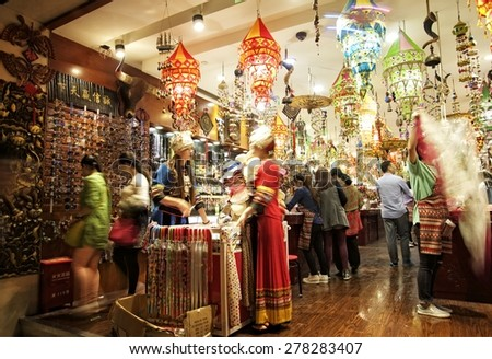 SHANGHAI, CHINA - MAY 2, 2015: Interior of a store with Chinese items at the famous Nanjing Road. It is the main shopping street of Shanghai, China, and is one of the world's busiest shopping streets.