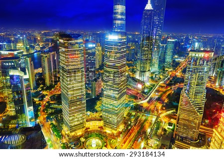 SHANGHAI, CHINA - MAY 24, 2015: Night view of city buildings of Pudong, Shanghai, China. Most modern city on continental part of China. - stock photo