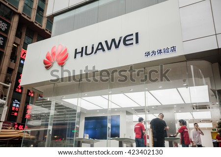 SHANGHAI, CHINA - MAY 5, 2016: People in seen at a Huawei store; Huawei, a Chinese multinational company, is the largest telecommunications equipment maker in the world.