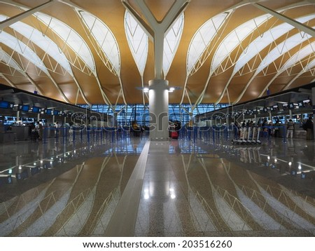 SHANGHAI, CHINA - MAY 24: Pudong Airport interior on May 24, 2014 in Shanghai, China. Pudong airport is the busiest international hub of mainland China, third busiest by cargo traffic in the world.