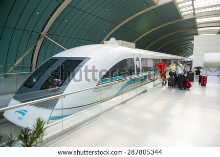 SHANGHAI, CHINA - MAY 9, 2015: The Maglev Train or Shanghai Transrapid is the first commercially operated high-speed magnetic levitation line in the world. Its commercial speed is 431 km/h (268 mph). - stock photo