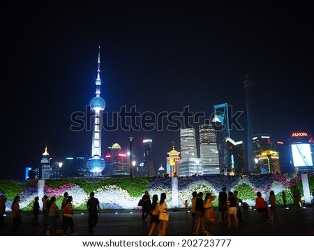 SHANGHAI, CHINA - MAY 23: The Pudong skyline by night viewed from the Bund on May 23, 2014 in Shanghai, China.