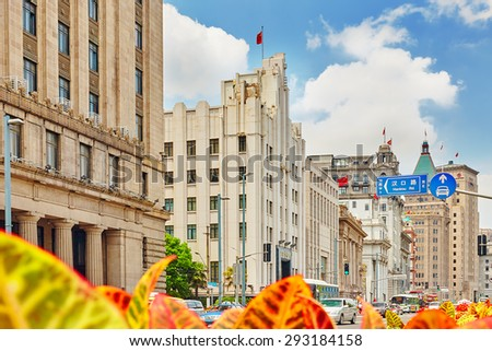 SHANGHAI, CHINA - MAY 25,2015: View of Shanghai -  Bund or Waitan waterfront. Shanghai waterfront Bund has historical buildings and it is one of the most famous tourist places in Shanghai. - stock photo