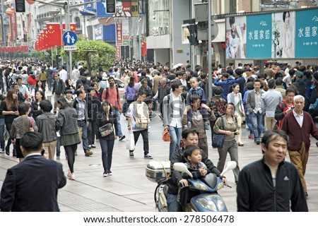 SHANGHAI, CHINA - MAY 2, 2015: Visitors at Nanjing Road. It is the main shopping street of Shanghai, China, and is one of the world's busiest shopping streets. - stock photo