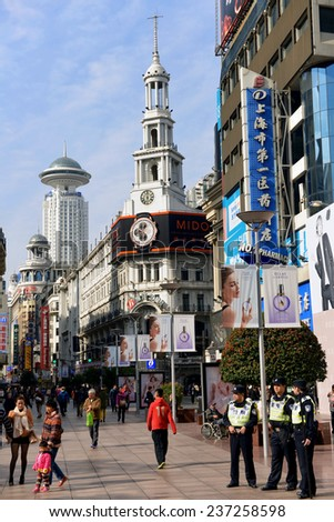 SHANGHAI, CHINA - NOV 13, 2014: Nanjing Road in Shanghai, one of the busiest shopping streets in the world.  This part of the street is for pedestrians only. - stock photo
