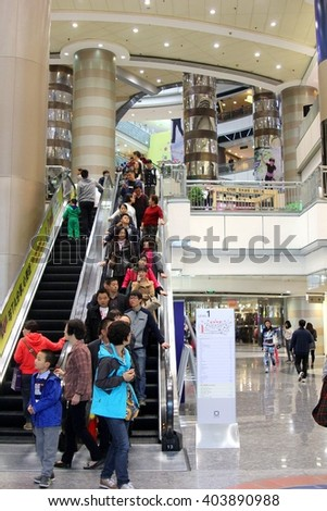 SHANGHAI, CHINA - November 9. Chinese people are shopping in a modern shopping mall on November 9, 2014 in Shanghai.  - stock photo
