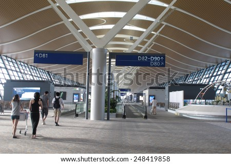 SHANGHAI, CHINA - OCT 24, 2014: Interior of the shanghai pudong airport. It is the primary international airport serving Shanghai, and a major aviation hub for Asia.                                - stock photo