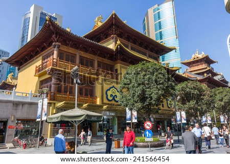 SHANGHAI, CHINA - OCT 24, 2014: Jing'an Temple is one of the most famous temples in Shanghai which is located at West Nanjing Road, the flourishing downtown area of Shanghai.  - stock photo