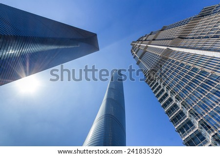 SHANGHAI, CHINA - OCT 24, 2014: Shanghai Tower, World Financial Center and Jin Mao Tower in Shanghai, China. These are the tallest buildings in Shanghai.  - stock photo