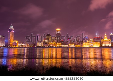 Shanghai, China, October 21, 2016, Editorial: Night view of the bund at a cloudy day after raining with golden light
