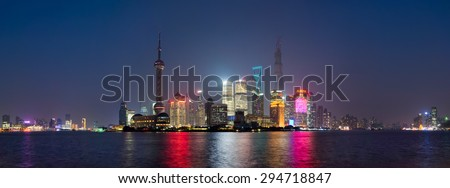 SHANGHAI, CHINA - OCTOBER 21, 2013: Panoramic view of Lujiazui and financial district skyscrapers from the Bund, in Shanghai, China, at night