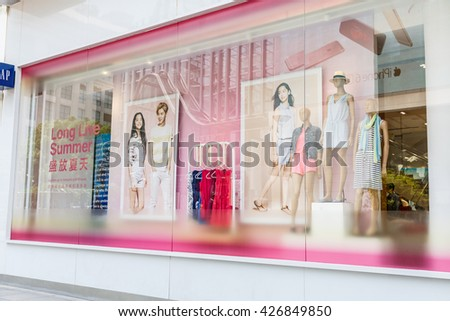 Shanghai, China - on May 11, 2016:shopping street Clothing display window in Nanjing Road?Nanjing Road is the main shopping street in Shanghai and one of the world's busiest commercial streets. - stock photo