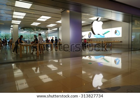 SHANGHAI, CHINA - Sept. 3, 2015: Apple flag-store in luxury shopping mall.According Umeng, China's largest analytic firm, 27% of China's smartphones cost over $500, and 80% of those are i Phones. - stock photo