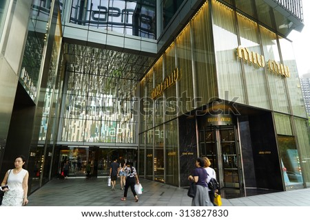 SHANGHAI, CHINA - Sept. 3, 2015: Miu Miu store at night. Miu Miu is Prada's secret weapon to win China's young luxury shoppers with its edgier image is propelling Prada's growth.
