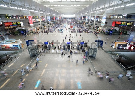 SHANGHAI, CHINA - Sept. 21, 2015: Passengers wait for trains in Shanghai Hongqiao Railway Station. It is the largest railway station in Asia with an area of 1.3 million square meters.