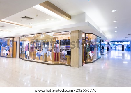 Shanghai,china-September 5, 2014:modern clothes retail shop in shopping mall - stock photo