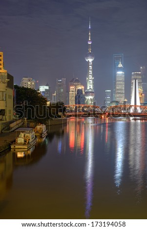 SHANGHAI, CHINA - SEPTEMBER 01: Nocturne view at Pudong with Oriental Pearl Tower, Financial and Jin Mao towers on September 01, 2012 in Shanghai.