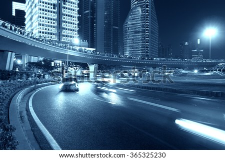 Shanghai city road light trails - stock photo