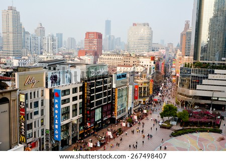 SHANGHAI, CN - MAR 17 2015:Visitors at Nanjing Road. It is the main shopping street of Shanghai, China, and is one of the world's busiest shopping streets.
