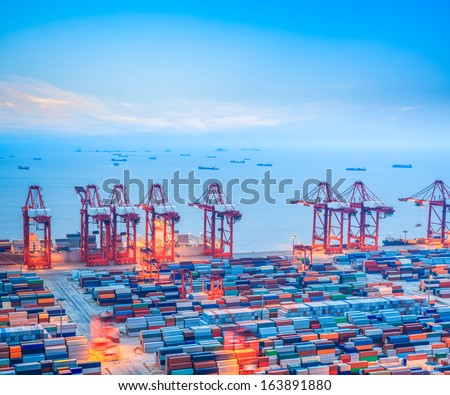 shanghai container terminal at dusk ,yangshan deep-water port , China  - stock photo