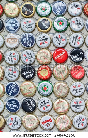 SHANGHAI-DEC. 4, 2014. Beer bottle caps collection. Beer sales in China rose 29 percent between 2006 and 2011 to 50 billion liters, more than double the consumption in the US, the next biggest market. - stock photo