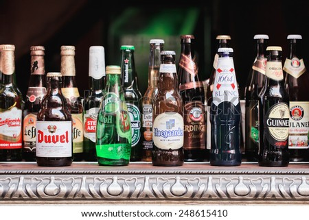 SHANGHAI-DEC. 4, 2014. Beer bottle collection. Beer sales in China rose 29 percent between 2006 and 2011 to 50 billion liters, more than double the consumption in the US, the next biggest market. - stock photo