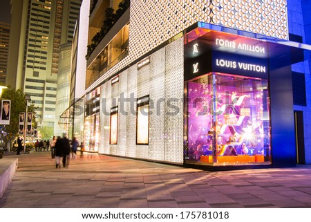 Shanghai - DEC 24: Louis Vuitton store at Plaza 66 Shopping Center at Nanjing West Road on Dec 24, 2013 in Shanghai, China. Now, there are many Louis Vuitton stores in Shanghai's shopping districts.  - stock photo